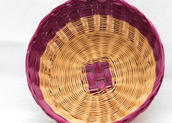Top view product picture of woven bread basket made from esparto natural fibers in red and natural esparto color