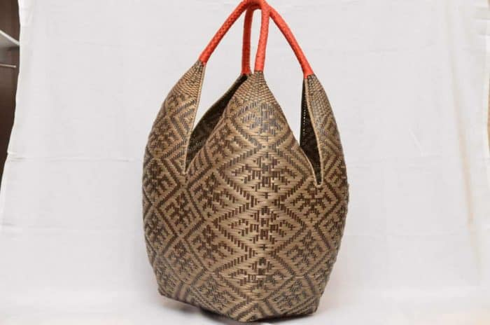 perspective picture of an extra Large Decorative Basket in Brown Spider Pattern with Golden Orange Handles