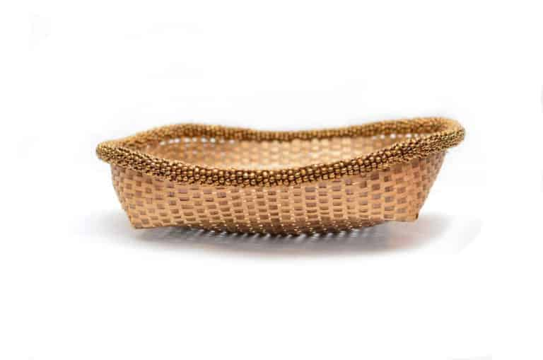 main product image of a Small Woven Basket with brown metallic beaded border, 11 inches wide