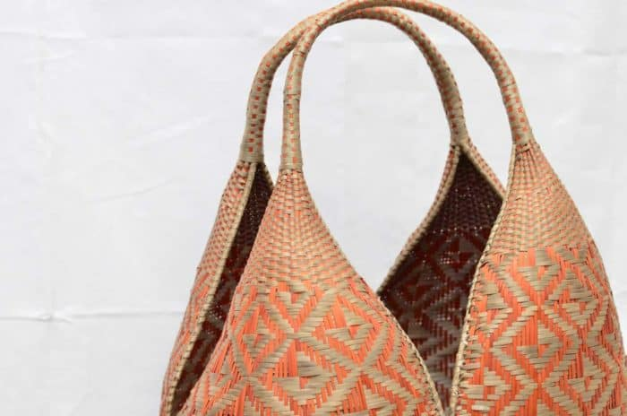 close up picture of golden orange cuatro tetas basket handles and butterfly woven pattern