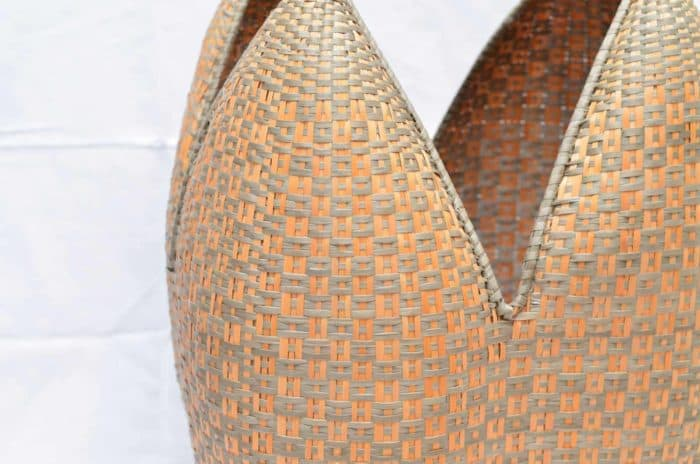 close up picture of a cuatro tetas basket Tan and Green Button Pattern