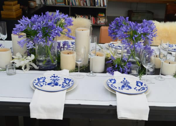 Picture of hand painted ceramic dinner plates on a beautifully decorated dinning table