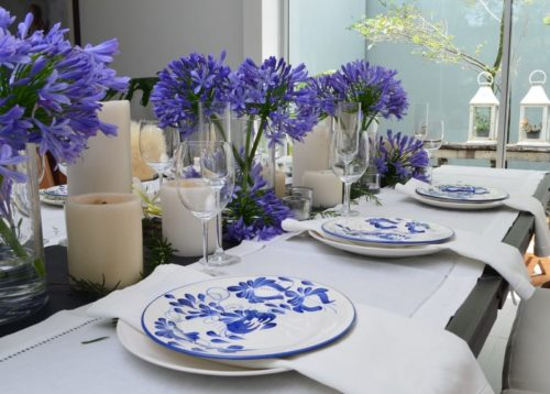 Picture of hand painted ceramic dinner plates on a luxury decorated dinning table