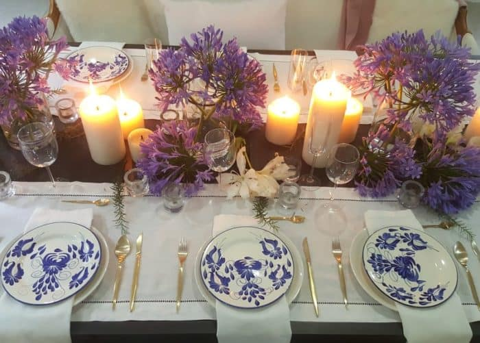 Picture of hand painted ceramic 10 inch dinner plates in a candlelight dinning setting