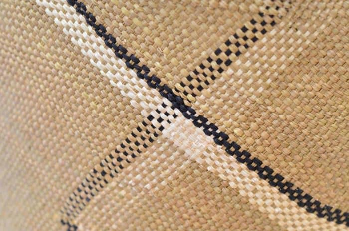Close Up Product Image of Large Woven Basket with Handles in Tan Iraca with Blue and White Stripe Pattern
