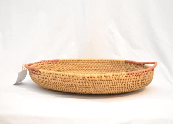 side view product image of a Round Serving Tray with Handles hand woven from Mamure natural fibers in Vichada Colombia.