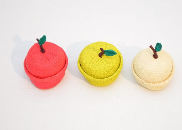 product image from above of three small apple shaped baskets in red, green and white colors
