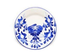 main product image of a colorful dinner plate hand painted on ceramic by artisans in El Carmen de Viboral, Colombia.