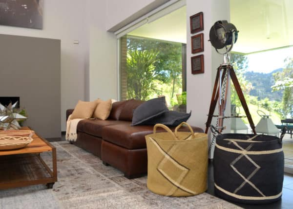Picture of two Iraca Large Woven Baskets in a living room setting