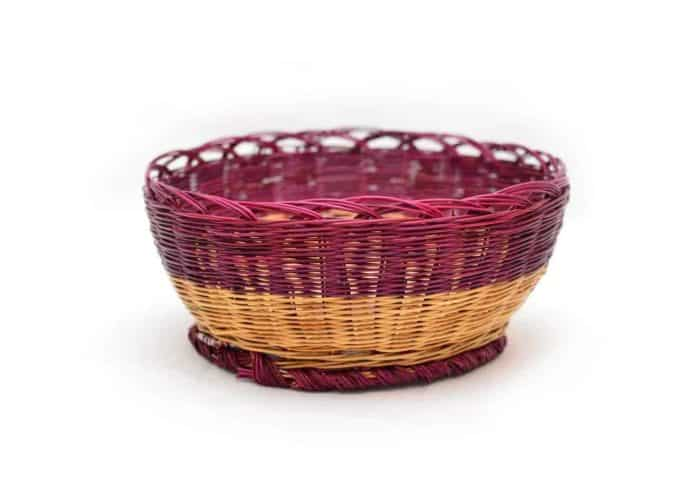 main product image of a woven bread basket made from esparto natural fibers in red and natural esparto colors