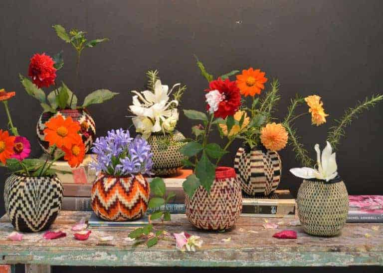 Picture of Various Werregue Decorative Vases with Flowers on Shabby Chic table