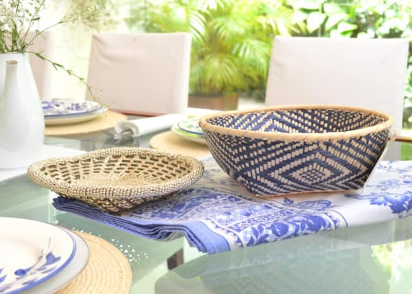 Close up picture of Bread basket made of paja tetera in white and blue pattern, and a small Bread Basket made of Iraca with White Beading border