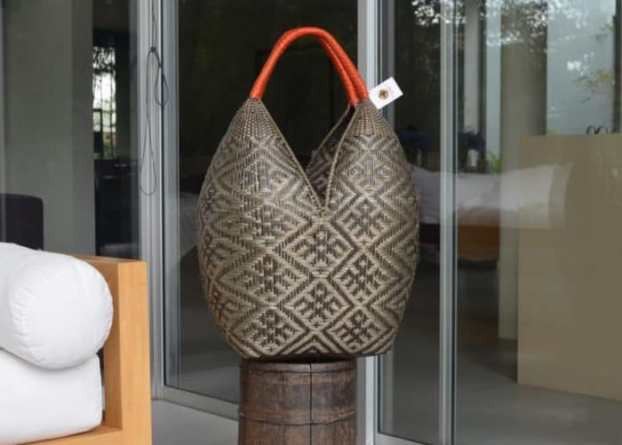picture of a Extra Large Decorative Basket on top of a wooden barrel