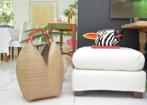 Picture of a large cuatro tetas basket hand woven in Guapi, Cauca and a decorative zebra head carved from wood in Galapa, Atlantico - Colombia