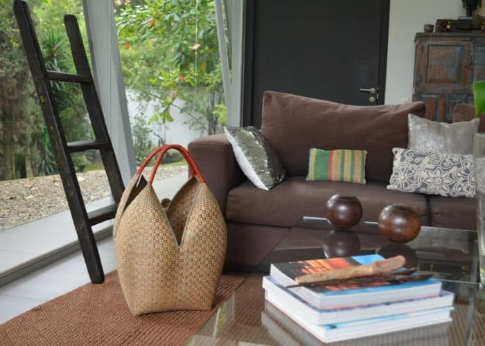 Picture of a Cuatro Tetas Basket Hand woven in Guapi, Cauca - Colombia sitting in a living room