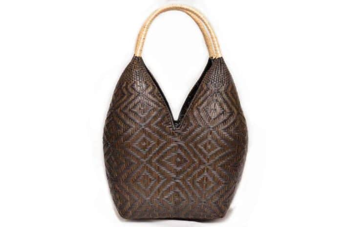 main product image of a cuatro tetas basket made from chocolatillo and paja tetera natural fibers in dark brown with beige handles