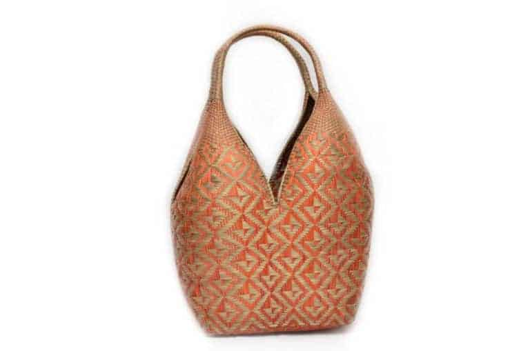 main product image of a Large Decorative Basket (Cuatro Tetas) in Golden Orange and Natural Green with Butterfly Pattern made from chocolatillo y paja tetera fibers in Guapi, Cauca - Colombia
