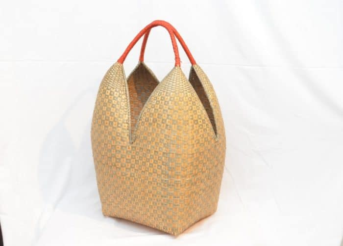 perspective product image f an Extra Large Decorative Basket (Cuatro Tetas) in Tan and Green Button Pattern (u Parapau k'a) and Orange Handles. Hand woven by the Eperaara Siapidaara community from chocolatillo y paja tetera natural fibers in Guapi, Cauca - Colombia