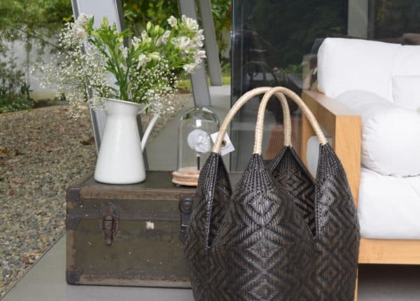product picture of a Large Cuatro Tetas Basket with Shrimp eye pattern in an outdoor setting decorated with flowers