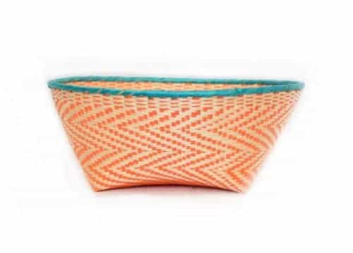 main product image of a small woven basket from paja tetera with aqua border and orange pattern