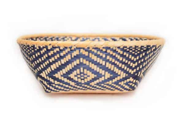 main product image of a small woven basket made from paja tetera natural fibers with beautiful white and blue pattern