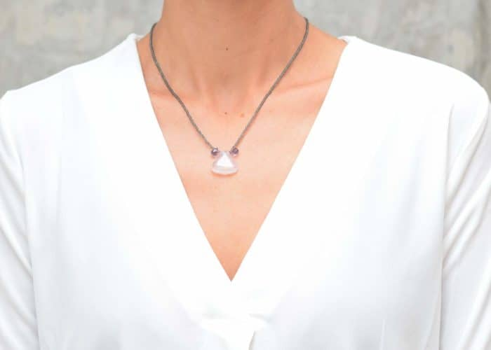 picture of a woman wearing a Quartz Pendant Necklace with Glass Beads and Faceted Amethyst Accent Drops by Kiskadee Design