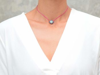 picture of a woman wearing a Enamel Charm Choker Necklace with Pink Silk Thread by Kiskadee Design