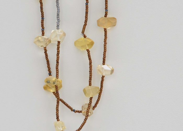 closer up picture of a Long Dainty Raw Citrine Quartz Necklace on white background by Kiskadee Design