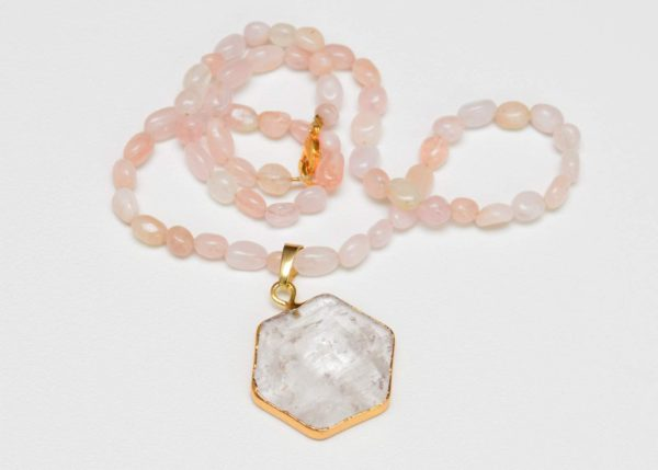 close up picture of a Pink Opal Necklace with Crystal Quartz Pendant on white background by Kiskadee Desig