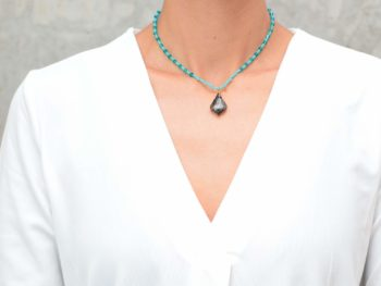 picture of a woman wearing a Turquoise Bead Necklace with Aquamarine Crystal Accents and Grey Crystal Pendant by Kiskadee Design