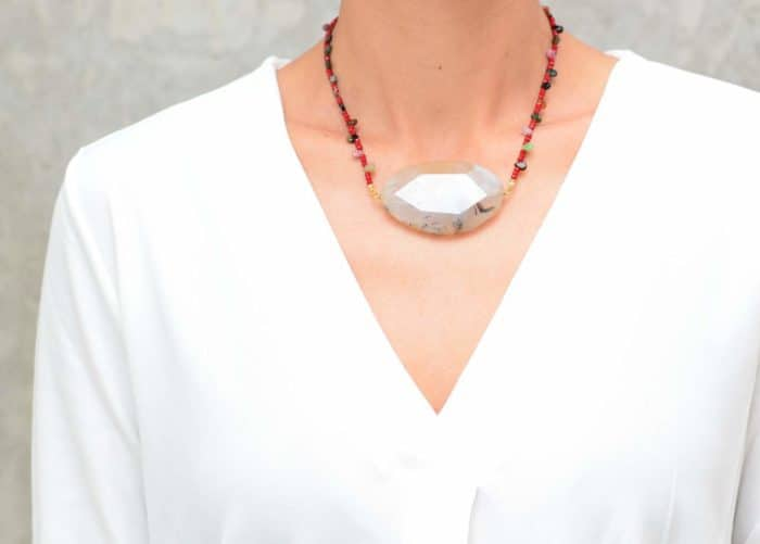 picture of a woman wearing an Agate Stone Necklace with Red Glass Beads and Tourmaline Drops by Kiskadee Design
