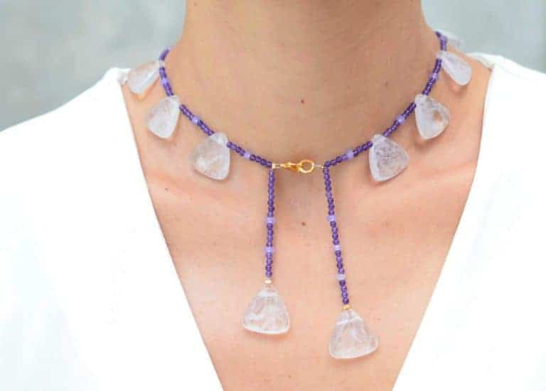 close up picture of a woman wearing an Amethyst Bead Necklace with Lavender Quartz Accents by Kiskadee Design