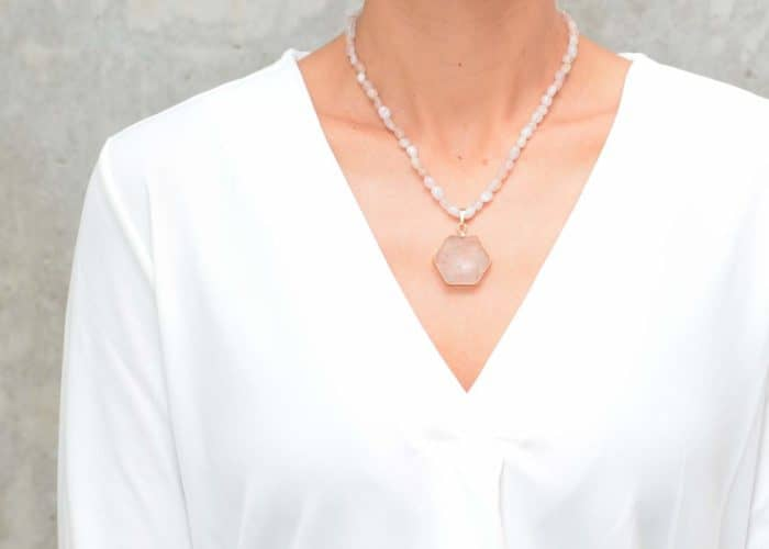 picture of a woman wearing a Pink Opal Necklace with Crystal Quartz Pendant by Kiskadee Design
