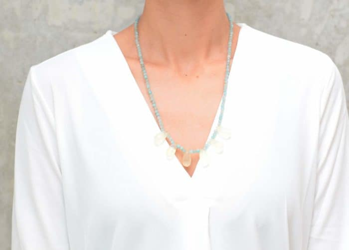 picture of a woman wearing a Smoky Quartz Necklace with Aquamarine Agate Beads by Kiskadee Design