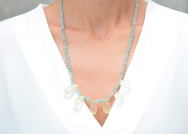 close up picture of a woman wearing a Smoky Quartz Necklace with Aquamarine Agate Beads by Kiskadee Design