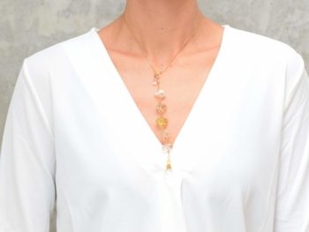 picture of a woman wearing a Raw Citrine Necklace with Delicate Gold-Filled Chain by Kiskadee Design