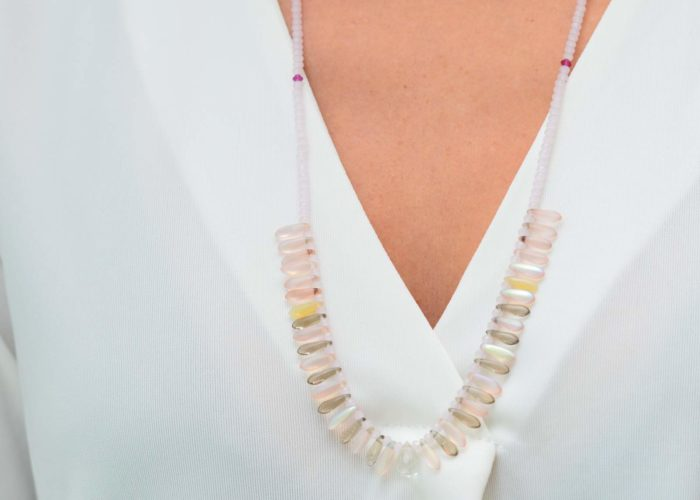 close up picture of a woman wearing a Pink Murano Glass Bead Necklace with Pink and Grey Point Czech Bead Accents + Faceted Clear Crystal Drop by Kiskadee Design