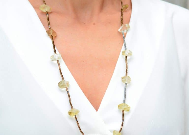 close up picture of a woman wearing a Long Dainty Raw Citrine Quartz Necklace by Kiskadee Design