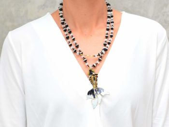 picture of a woman wearing a Enamel Fish Pendant on a Long Sardonyx and Crystal Bead Necklace by Kiskadee Design