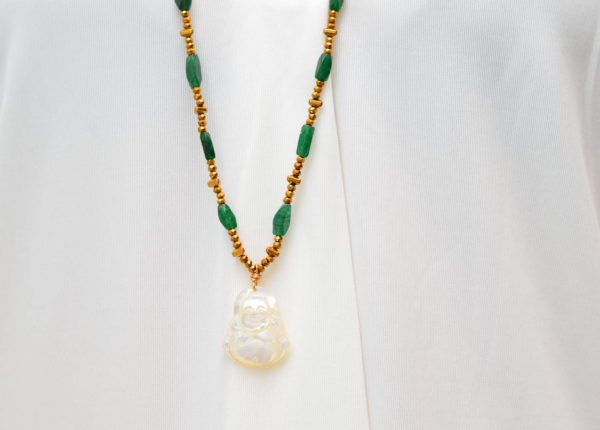 close up picture of a woman wearing a Long Raw Emerald Necklace with Mother of Pearl Buddha Pendant by Kiskadee Design