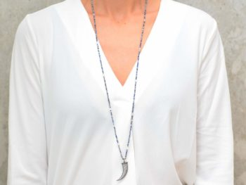 picture of a woman wearing a Lapis Lazuli Long Necklace with Fang Pendan by Kiskadee Design