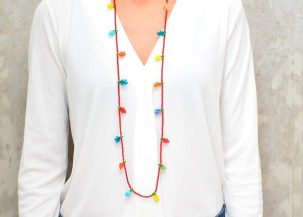 picture of a woman wearing a Red Murano Glass Necklace with Colorful Grape Accents by Kiskadee Design