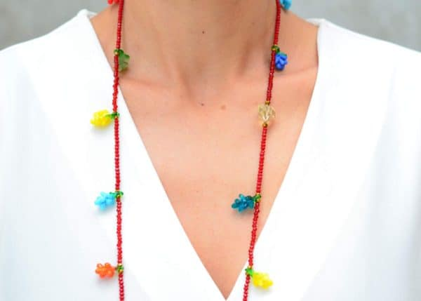 close up picture of a woman wearing a Red Murano Glass Necklace with Colorful Grape Accents by Kiskadee Design