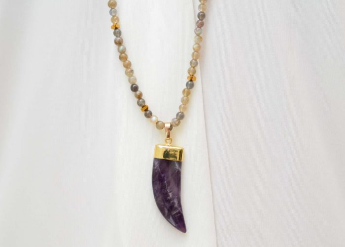 close up picture of a woman wearing a Long Labradorite Bead Necklace with Amethyst Pendant by Kiskadee Design