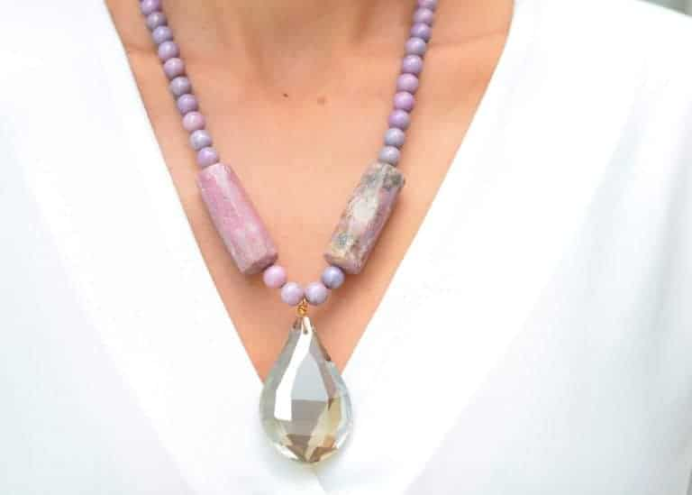 close up picture of a woman wearing a Lepidolite Necklace with tear-drop Grey Crystal Pendant by Kiskadee Design