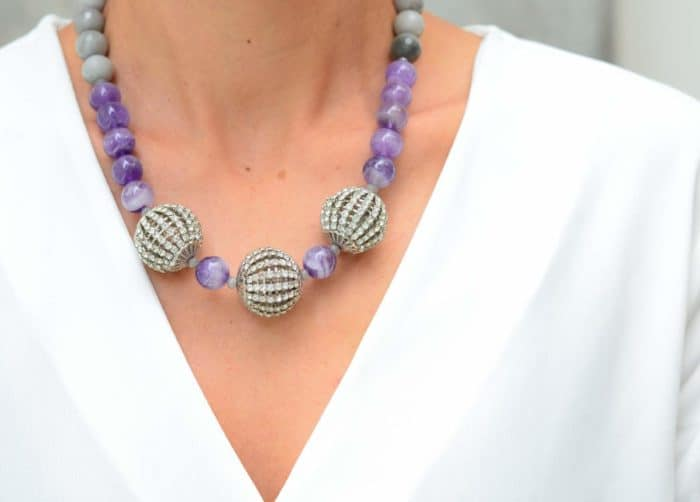 close up picture of a woman wearing an Amethyst Bead Necklace with Grey Agate and Crystal Accents by Kiskadee Design