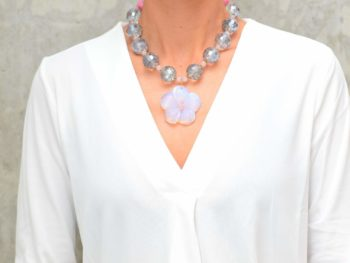 picture of a woman wearing a Opalite Pendant Necklace with Large Grey Crystal Beads by Kiskadee Design