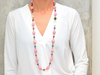 picture of a woman wearing a Long Rose Agate Stone Necklace with Crystals by Kiskadee Design