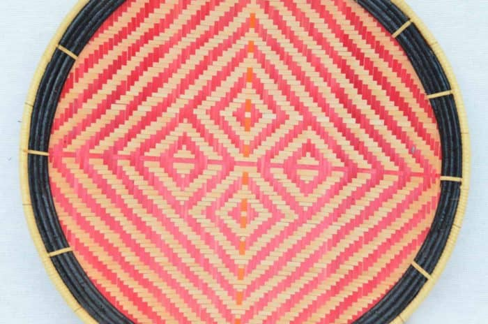 close up picture of a flat basket (aka. balay) with Red and White Tiger Skin Pattern with Black Frame