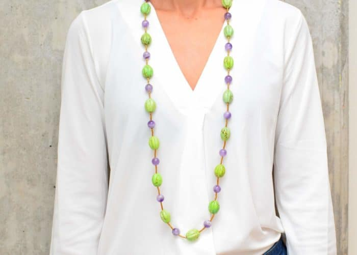 picture of a woman wearing a Gaspeite Necklace with Amethyst Beads by Kiskadee Design